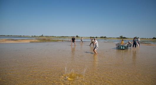 Water cricket before lunch at Xigera lagoon